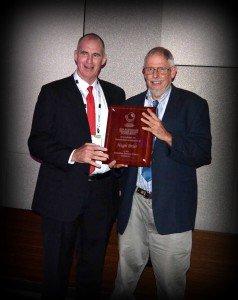 Paul McIntosh (Pulse Australia) presenting the summer grains industry award to Hugh Brier
